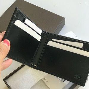 7e2749bf3e4 Gucci Bags - NWT Gucci GG canvas Slim Bifold Men s Wallet